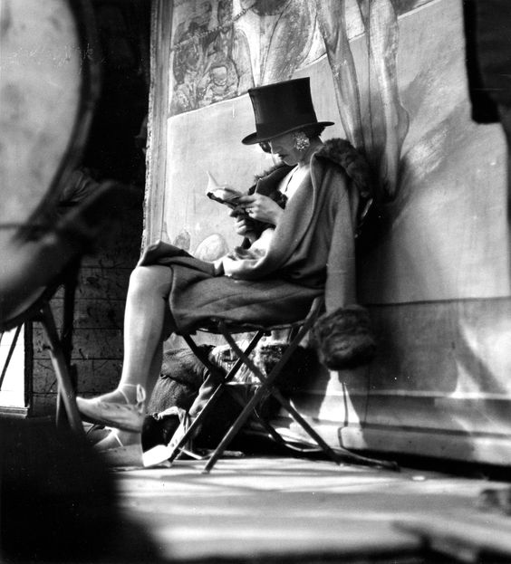 "André Kertész (France, born Hungary, 1894-1985) ""Carnival, Paris (woman reading behind stage)"" 1926 Gelatin silver print 10 3/4 x 13 inches © Courtesy Estate of André Kertész/Higher Pictures 2007"